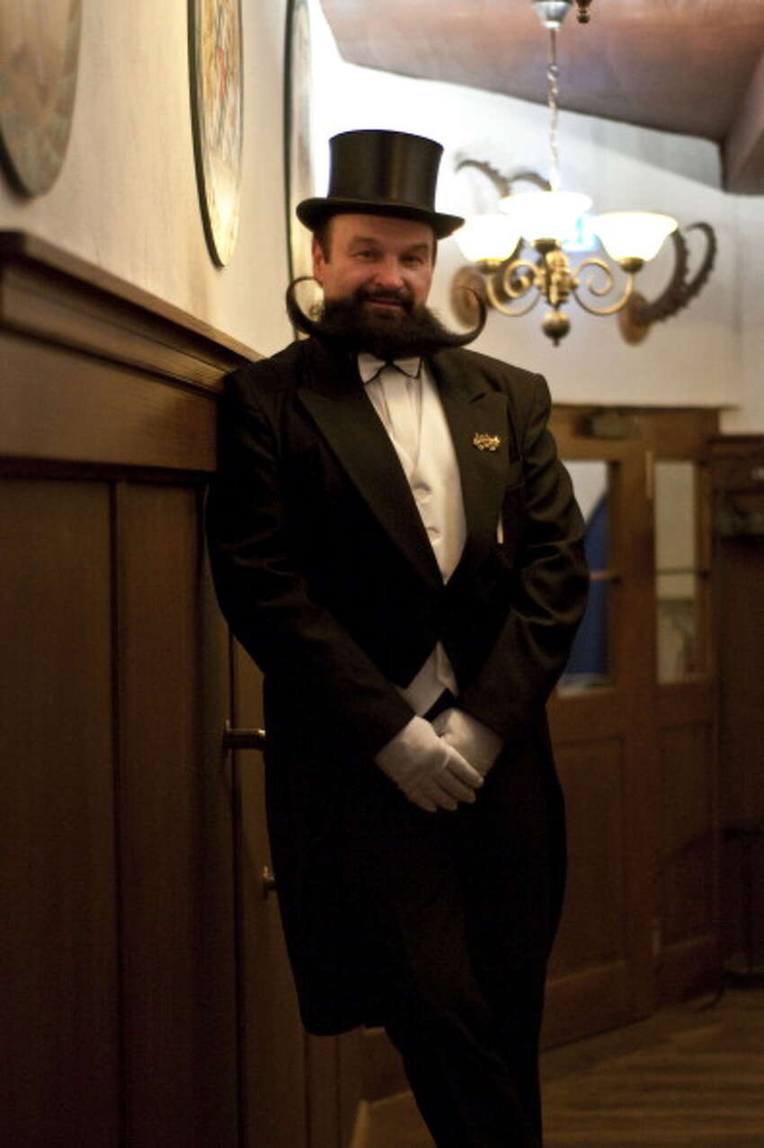 GARMISCH PARTENKIRCHEN, GERMANY - MARCH 26, 2011: Contestant of the Beard Championship held in Garmisch Partenkirchen posing in tailcoat and tophat, Germany.