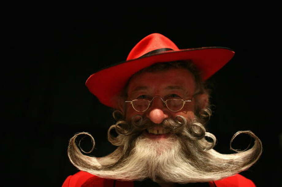 BRIGHTON, UNITED KINGDOM - SEPTEMBER 01:  A competitor poses for a photograph whilst competing during the World Beard and Moustache Championships at the Brighton Centre on September 1, 2007 in Brighton, England. The World Beard and Moustache Championships is a biennial event participated by beard and moustache wearers from all over the world. Photo: Daniel Berehulak, Getty Images / 2007 Getty Images