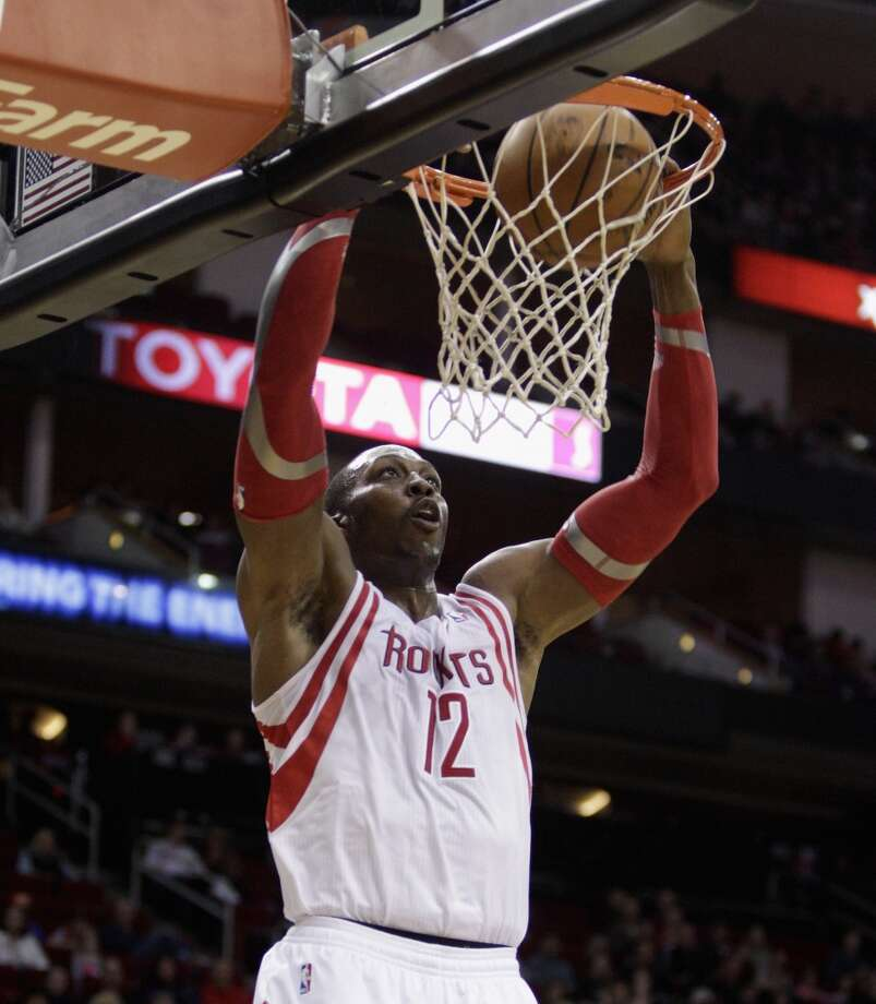 Nov. 23: Rockets 112, Timberwolves 101   Rockets power forward Dwight Howard (12) dunks in the first quarter. Photo: Bob Levey, Houston Chronicle