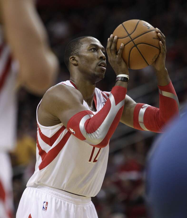 Rockets power forward Dwight Howard (12) shoots a free throw. Photo: Bob Levey, Houston Chronicle