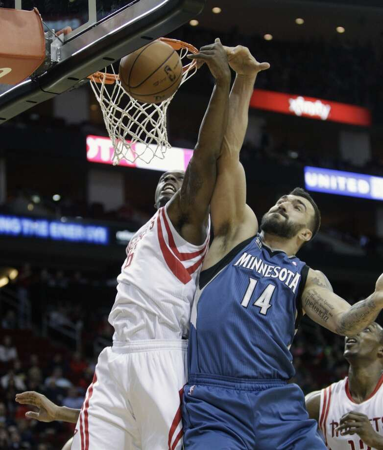 Rockets power forward Terrence Jones (6) and Timberwolves center Nikola Pekovic (14) battle for a rebound. Photo: Bob Levey, Houston Chronicle