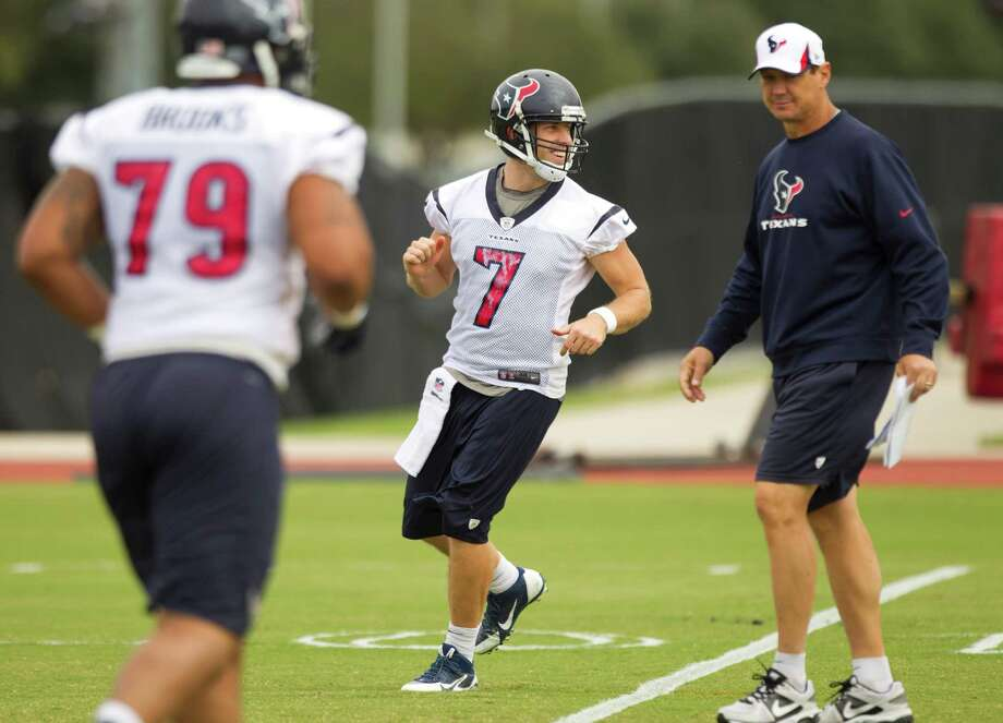 Under the scrutiny of Texans offensive coordinator Rick Dennison, right, Case Keenum (7) is trying to make the necessary adjustments to excel at quarterback. Photo: Brett Coomer, Staff / © 2013  Houston Chronicle