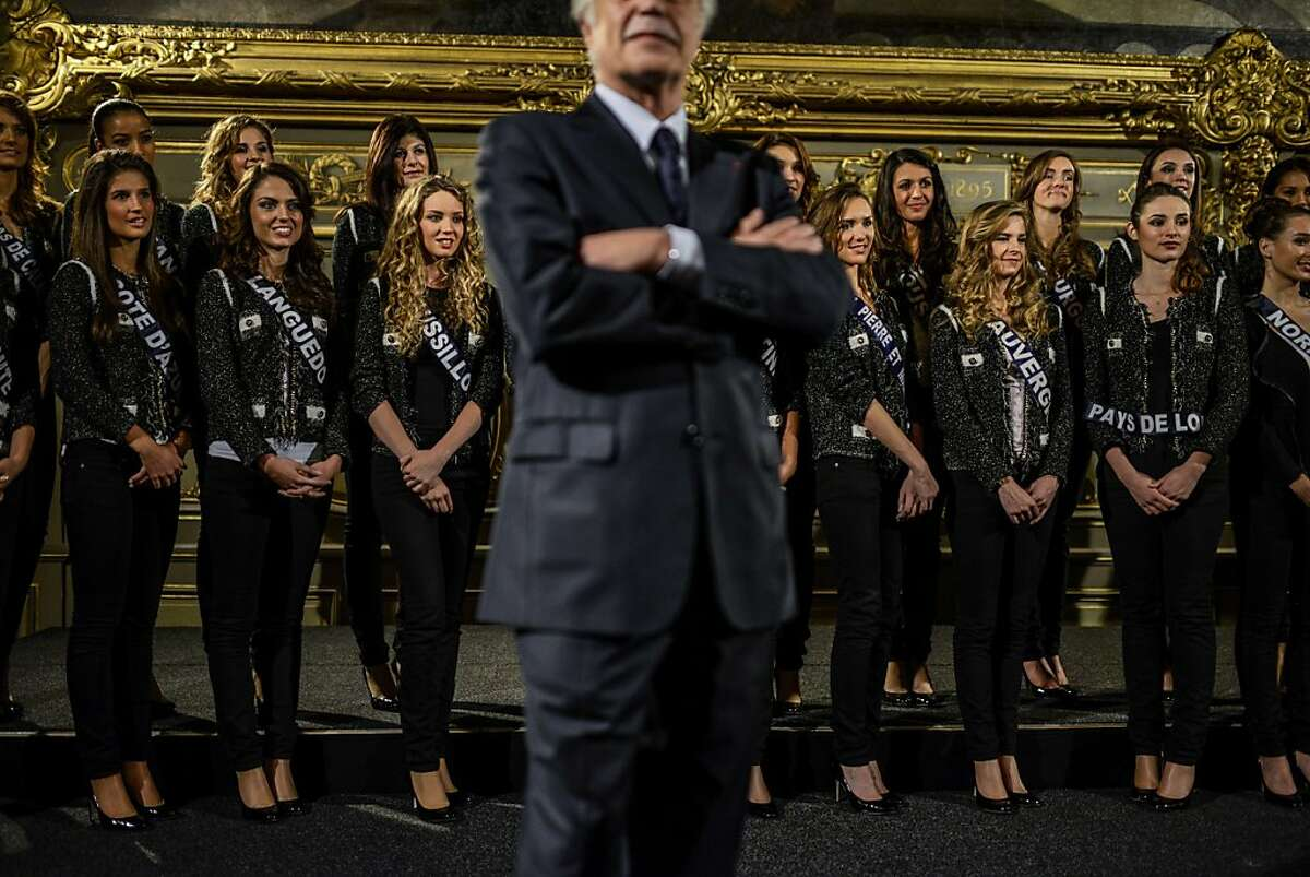 TOPSHOTS Dijon's mayor and senator Francois Rebsamen (C) stands in front of Miss France 2014 contestants on November 23, 2013 at the city hall in Dijon. The beauty contest will take place on December 7, 2013. TOPSHOTS/AFP PHOTO / JEFF PACHOUDJEFF PACHOUD/AFP/Getty Images