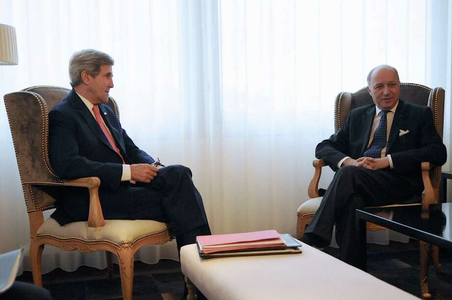 """In this image released by the US State Department, US Secretary of State John Kerry (L) sits with French Minister Laurent Fabius before a bilateral meeting on the margins of talks focused on Iran's nuclear capabilities, Geneva, Switzerland, on November 23, 2013. Negotiations between world powers and Iran over Tehran's nuclear ambitions were thrown into uncertainty Saturday after US Secretary of State John Kerry announced his imminent departure and Iran's chief negotiator expressed doubts a deal would be reached. Amid signs that the talks in Geneva were proving difficult, Kerry's spokesman said the US's top diplomat would leave for London on Sunday for meetings with British counterpart William Hague and the Libyan prime minister.    = RESTRICTED TO EDITORIAL USE- MANDATORY CREDIT """"AFP PHOTO / US STATE DEPARTMENT"""" -NO MARKETING NO ADVERTISING CAMPAIGNS - DISTRIBUTED AS A SERVICE TO CLIENTS =-/AFP/Getty Images Photo: -, Handout / AFP"""