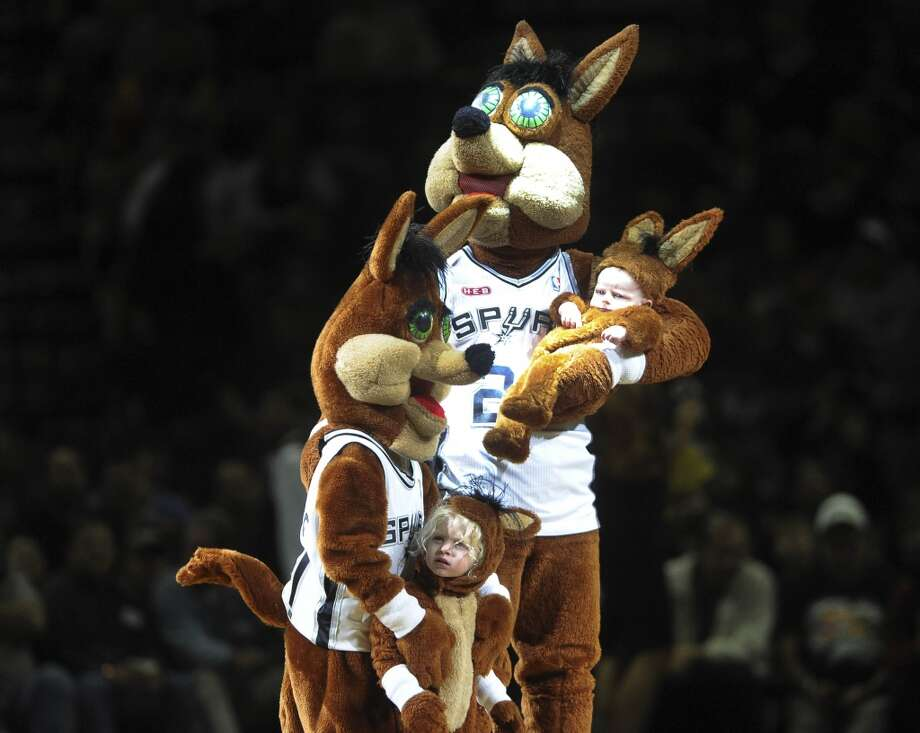 The San Antonio Spurs Coyote and family entertain fans during the Cleveland Cavaliers at Spurs NBA game in the AT&T Center on Saturday, Nov. 23, 2013. Photo: Billy Calzada, San Antonio Express-News