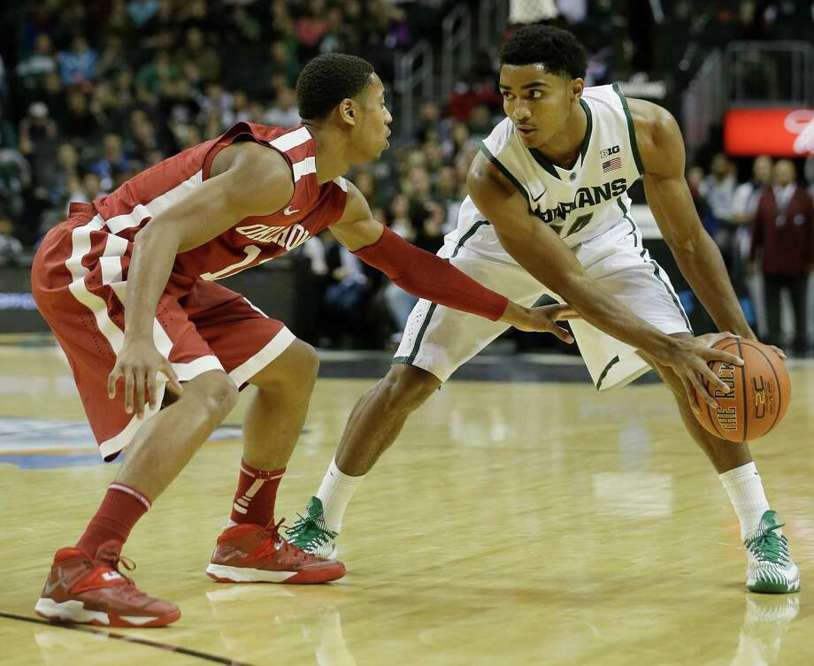 Oklahoma's Isaiah Cousins (11) guards Michigan State's Gary Harris (14) during the first half of the championship game in the Coaches vs. Cancer NCAA college basketball game on Saturday, Nov. 23, 2013, in New York. (AP Photo/Frank Franklin II) ORG XMIT: NYFF113 Photo: Frank Franklin II / AP