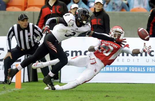 A potential touchdown pass to UH's Demarcus Ayers is tantalizingly close before falling incomplete, with Howard Wilder covering. Photo: J. Patric Schneider, Freelance / © 2013 Houston Chronicle