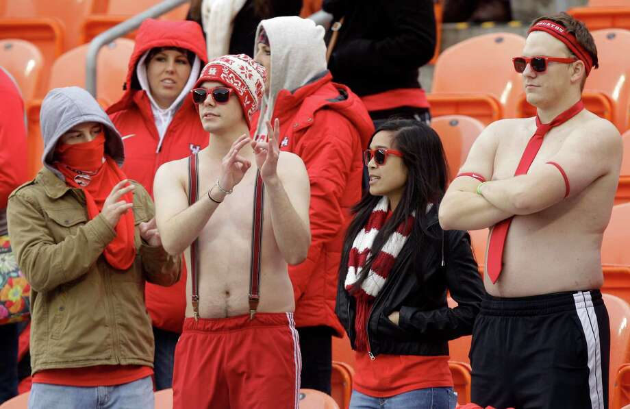 UH students varied their approaches to dealing with Saturday's chilly weather. Photo: J. Patric Schneider, Freelance / © 2013 Houston Chronicle
