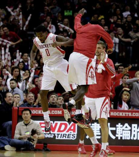 Rockets backup point guard Aaron Brooks (0) and teammate Pat Beverley, right, were walking on air after Brooks connected on a 3-pointer against Minnesota. Brooks scored 26 points, including six 3-pointers. Photo: Bob Levey, Special To The Chronicle / ©2013 Bob Levey