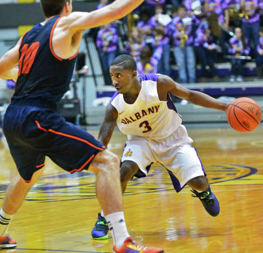 UAlbany's #3 DJ Evans is guarded by Bucknell's #10 Brian Fitzpatrick during Saturday's game at the Sefcu Arena Nov. 23, 2013, in Abany, NY.  (John Carl D'Annibale / Times Union) Photo: John Carl D'Annibale / 00024711A