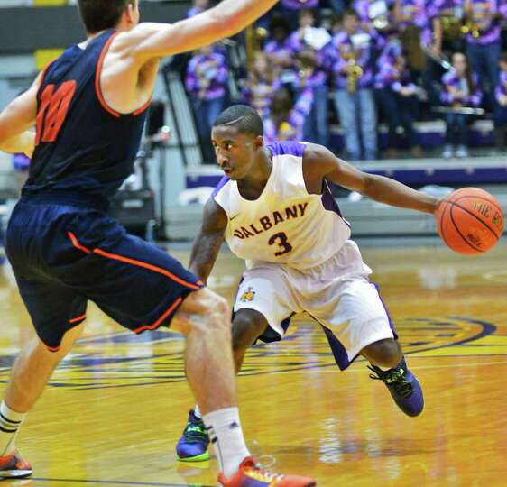 UAlbany's #3 DJ Evans is guarded by Bucknell's #10 Brian Fitzpatrick during Saturday's game at the S
