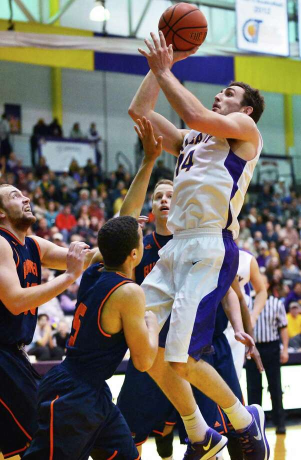 UAlbany's #14 Sam Rowley drives to the hoop during Saturday's game against Bucknell at the Sefcu Arena Nov. 23, 2013, in Abany, NY.  (John Carl D'Annibale / Times Union) Photo: John Carl D'Annibale / 00024711A