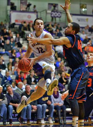 UAlbany's #12 Peter Hooley gets a pass by Bucknell's #42 Cameron Ayers during Saturday's game at the
