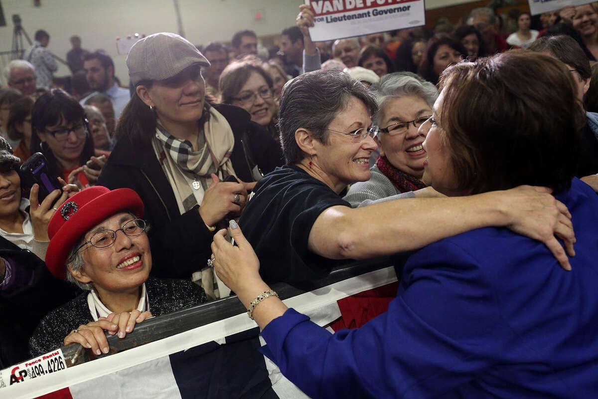 State Sen. Leticia Van de Putte embraces Bonnie Dietering while Luz Solis Day (left) waits her turn after Van De Putte announced her run for lieutenant governor on Saturday.