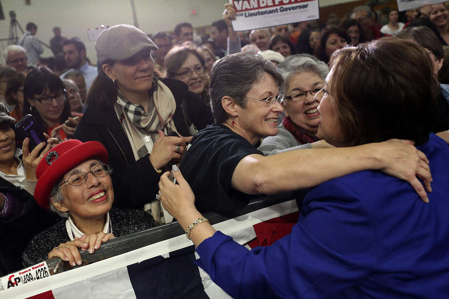 State Sen. Leticia Van de Putte embraces Bonnie Dietering while Luz Solis Day (left) waits her turn after Van De Putte announced her run for lieutenant governor on Saturday. Photo: Photos By Lisa Krantz / San Antonio Express-News