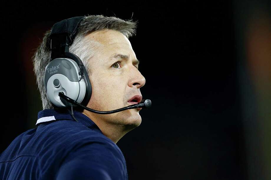 EAST HARTFORD, CT - NOVEMBER 08:  Head coach T.J. Weist of the Connecticut Huskies looks on from the sideline against the Louisville Cardinals at Rentschler Field during the game on November 8, 2013 in East Hartford, Connecticut. Photo: Jared Wickerham, Getty Images / 2013 Getty Images