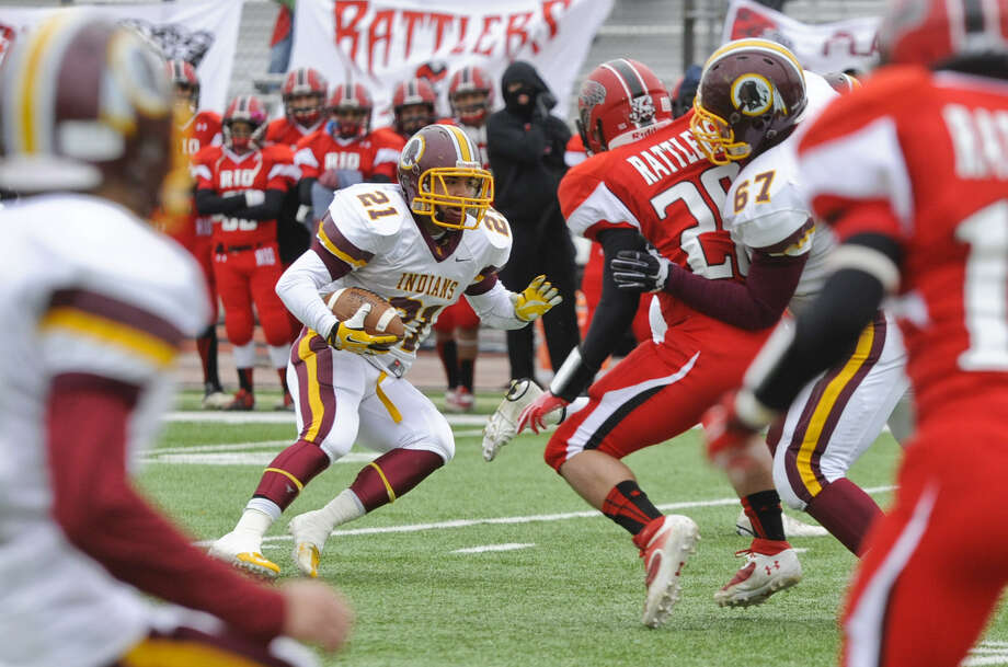 Harlandale running back Nicolas Martinez (left) maneuvers his way through Rio Grand City's defensive line Saturday in Laredo. Photo: Danny Zaragoza / Laredo Morning News