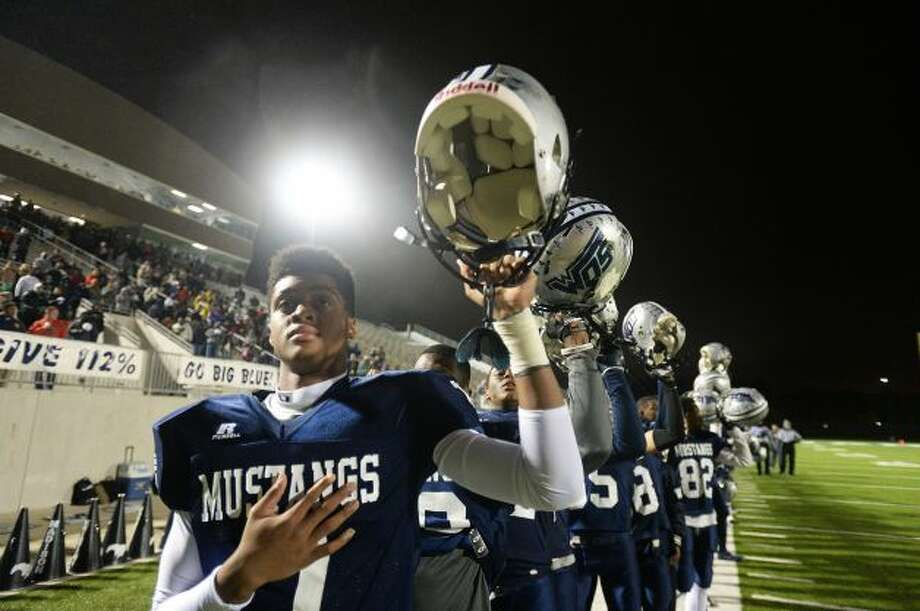 West Orange-Stark players hold up their helmets before last Friday's playoff game. The Mustangs won and will face Jasper this coming Friday in Humble at 7 p.m. Enterprise photo