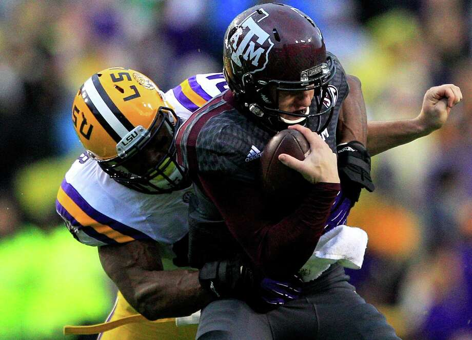 BATON ROUGE, LA - NOVEMBER 23:  Quarterback Johnny Manziel #2 of the Texas A&M Aggies is sacked by defensive end Danielle Hunter #94 of the LSU Tigers at Tiger Stadium on November 23, 2013 in Baton Rouge, Louisiana. Photo: Sean Gardner, Getty Images / 2013 Getty Images