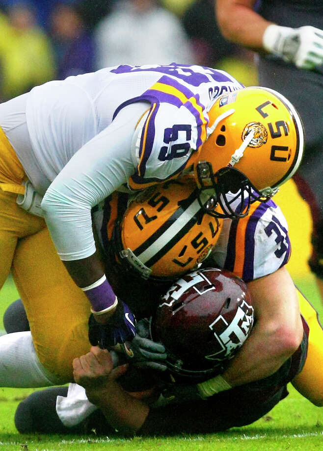 LSU's defense made life difficult for Johnny Manziel on Saturday, particularly on this second-quarter play.  LSU's defense made life difficult for Johnny Manziel on Saturday, particularly on this second-quarter play. Photo: Cody Duty, Staff / © 2013 Houston Chronicle