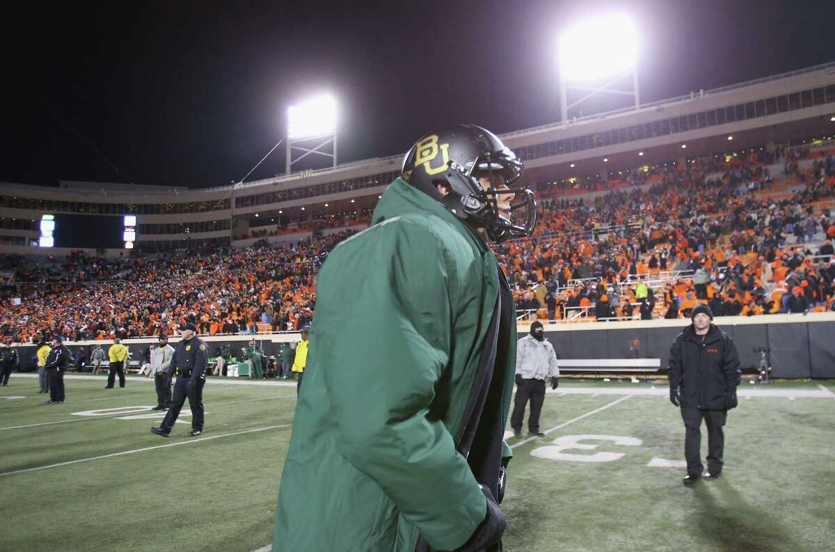 STILLWATER, OK - NOVEMBER 23: Bryce Petty #14 of the Baylor Bears runs off the field after a loss against the Oklahoma State Cowboys at Boone Pickens Stadium on November 23, 2013 in Stillwater, Oklahoma.