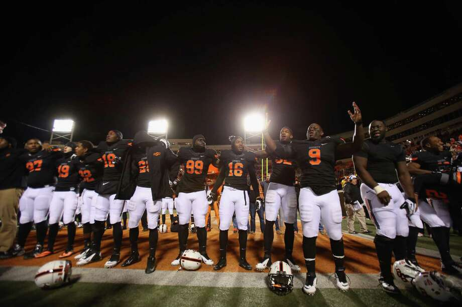 STILLWATER, OK - NOVEMBER 23:  The Oklahoma State Cowboys celebrate a 49-17 win against the Baylor Bears at Boone Pickens Stadium on November 23, 2013 in Stillwater, Oklahoma. Photo: Ronald Martinez, Getty Images / 2013 Getty Images