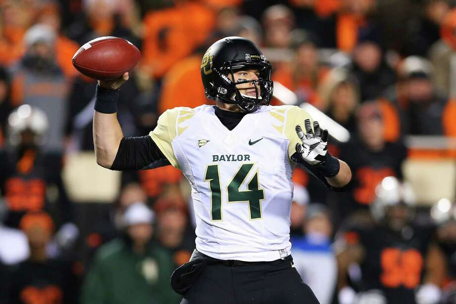 STILLWATER, OK - NOVEMBER 23:  Bryce Petty #14 of the Baylor Bears looks to pass in the second quarter against the Oklahoma State Cowboys at Boone Pickens Stadium on November 23, 2013 in Stillwater, Oklahoma. Photo: Ronald Martinez, Getty Images / 2013 Getty Images