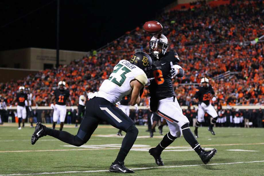 STILLWATER, OK - NOVEMBER 23:  Daytawion Lowe #8 of the Oklahoma State Cowboys breaks up a pass intended for Clay Fuller #23 of the Baylor Bears in the second quarter at Boone Pickens Stadium on November 23, 2013 in Stillwater, Oklahoma. Photo: Ronald Martinez, Getty Images / 2013 Getty Images