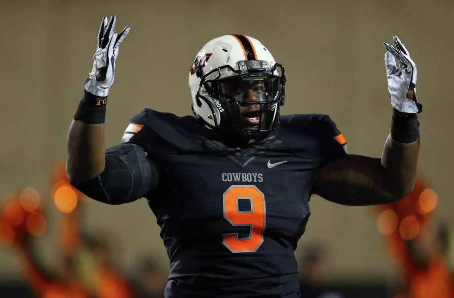 STILLWATER, OK - NOVEMBER 23:  Kye Staley #9 of the Oklahoma State Cowboys celebrates his touchdown against the Baylor Bears in the third quarter at Boone Pickens Stadium on November 23, 2013 in Stillwater, Oklahoma. Photo: Ronald Martinez, Getty Images / 2013 Getty Images