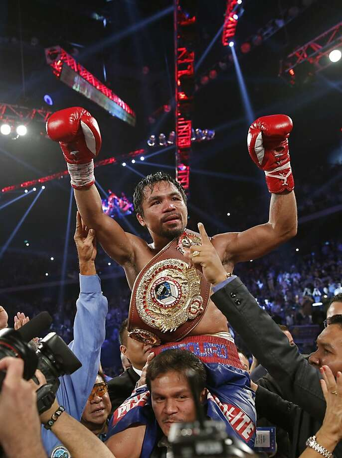 Manny Pacquiao's victory brought not only a sense of redemption after two losses, but a lift for the Philippines. Photo: Vincent Yu, Associated Press