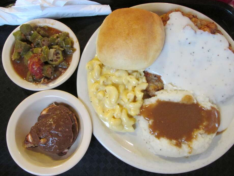 Chicken fried steak with white gravy, mashed potatoes with brown gravy, mac and cheese, roll, okra and tomatoes and the chocolate surprise at Lercy's Diner in Winnie. Photo: Cat5