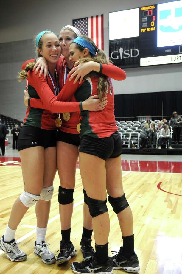 The Woodlands senior outside hitter Madison McDaniel, left, with Morgan Eason, and their Lady Highlander teammates celebrate their straight sets win over San Antonio Churchill to capture the 2013 UIL Class 5A State Volleyball Champions at the Culwell Center in Garland on Saturday.
