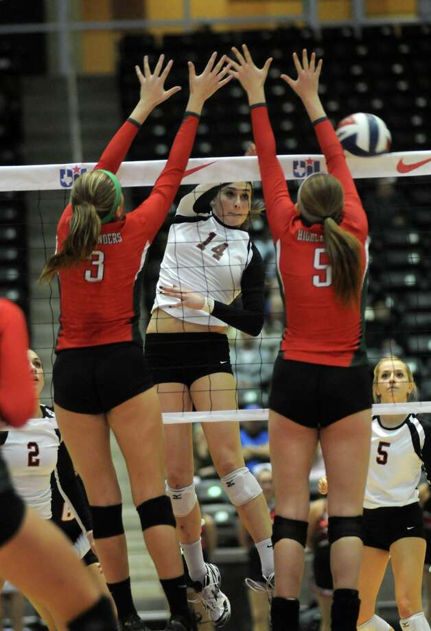 San Antonio Churchill's Abby Buckingham, center, works at the net against The Woodlands seniors Madison McDaniel, left, and Morgan Eason, during their 2013 UIL Class 5A State Volleyball Championship match at the Culwell Center in Garland on Saturday.