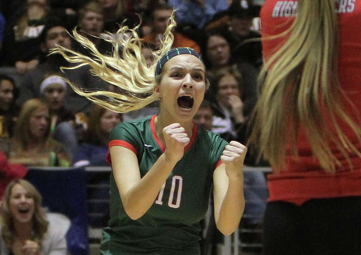 The Woodlands' Kelly Quinn (10) celebrates a point during a Class 5A UIL Volleyball State Championship game Saturday, Nov. 23, 2013, in Garland, Texas. The Woodlands defeated San Antonio Churchill in straight sets to became the 18th undefeated volleyball state champion in UIL history since 1967. (AP Photo/ The Courier, Jason Fochtman)