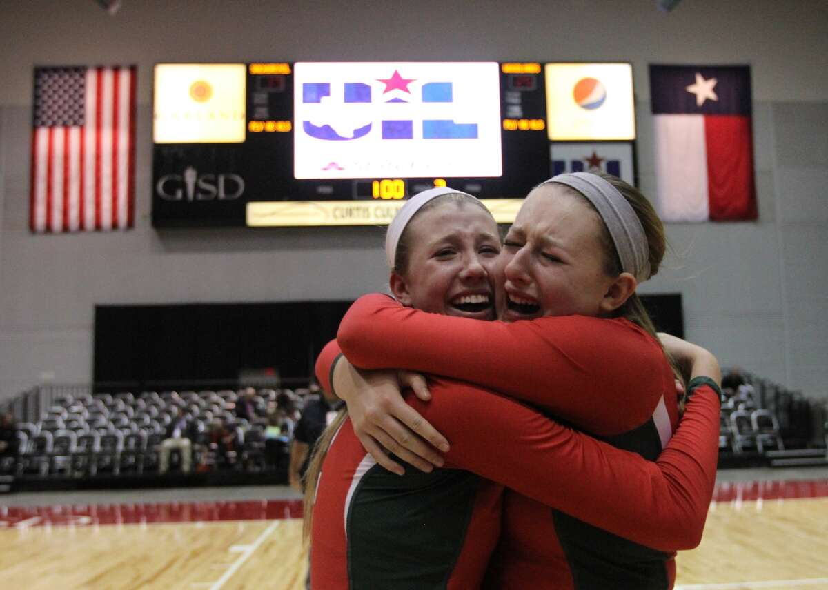The Woodlands' Rachel Reed (12) and Morgan Eason (5) celebrate after defeating San Antonio Churchill in straight sets to win the Class 5A UIL Volleyball State Championship Saturday, Nov. 23, 2013, in Garland, Texas. The Woodlands became the 18th undefeated volleyball state champion in UIL history since 1967. (AP Photo/ The Courier, Jason Fochtman)