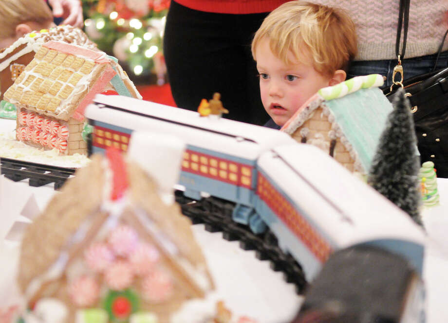 "Connor Trepp, 3, watches a train weave through a ginger bread fantasy land during the Junior League of Greenwich's Enchanted Forest annual fundraiser at the Hyatt Regency Greenwich in Greenwich, Conn., Nov. 24, 2013. This year's event featured a ""Celebration of Sweetness"" theme along with a visit from Santa and countless boutiques for holiday shopping. Photo: Keelin Daly / Stamford Advocate Freelance"