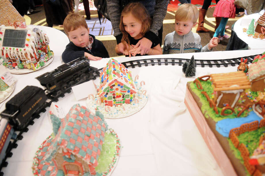 "Kids watch a holiday train wind through a candy land during the Junior League of Greenwich's Enchanted Forest annual fundraiser at the Hyatt Regency Greenwich in Greenwich, Conn., Nov. 24, 2013. This year's event featured a ""Celebration of Sweetness"" theme along with a visit from Santa and countless boutiques for holiday shopping. Photo: Keelin Daly / Stamford Advocate Freelance"