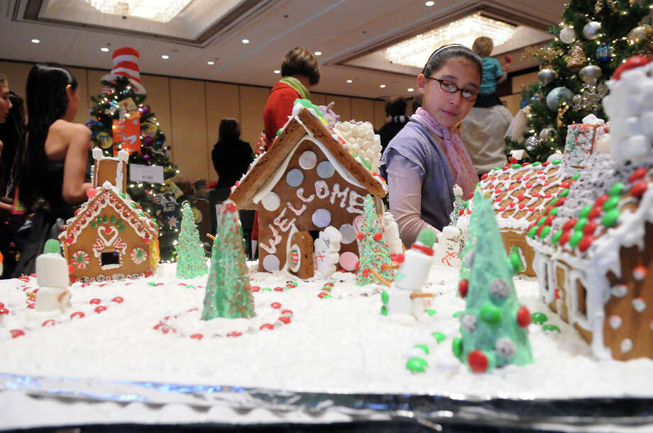 "Lucy Connolly, 9, eyes the gingerbread creations at the Junior League of Greenwich's Enchanted Forest annual fundraiser at the Hyatt Regency Greenwich in Greenwich, Conn., Nov. 24, 2013. This year's event featured a ""Celebration of Sweetness"" theme along with a visit from Santa and countless boutiques for holiday shopping. Photo: Keelin Daly / Stamford Advocate Freelance"