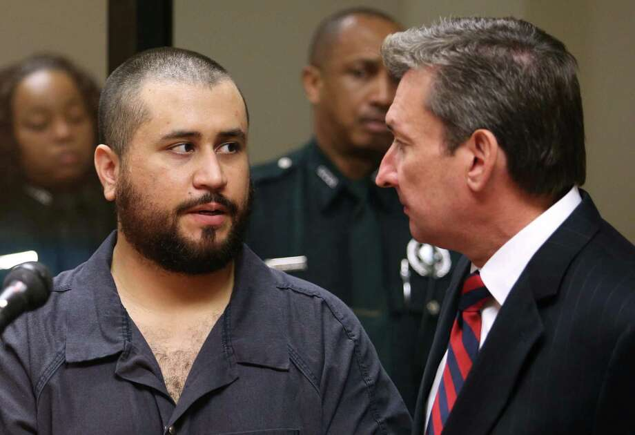 George Zimmerman, acquitted in the high-profile killing of unarmed black teenager Trayvon Martin, faces his defense counsel Jeff Dowdy in court Tuesday, Nov. 19,  2013, in Sanford, Fla., during his hearing on charges including aggravated assault stemming from a fight with his girlfriend. Photo: Joe Burbank, AP / AP2013