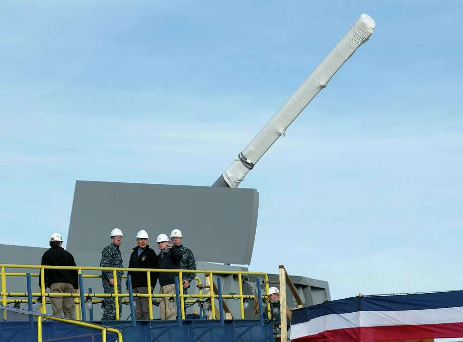 FILE - In a Thursday, Nov. 21, 2013 file photo, Defense Secretary Chuck Hagel, center, tours the Zumwalt destroyer at Bath Iron Works during his first visit to Maine since being confirmed, in Bath, Maine. The skipper of the technology-laden Zumwalt Capt. James Kirk's futuristic-looking vessel sports cutting-edge technology, new propulsion and powerful armaments, but this ship isn't the Starship Enterprise. The technology-laden Zumwalt taking shape at Maine's Bath Iron Works is unlike any other U.S. warship. Photo: Robert F. Bukaty, AP / AP