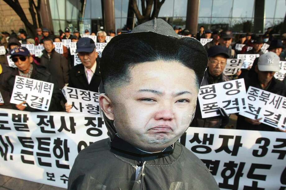 "An effigy of North Korean leader Kim Jong Un is displayed during a rally to mark the the third anniversary of North Korea's artillery attack on the Yeonpyeong island, in Seoul, South Korea, Saturday, Nov. 23, 2013. Four people, including two marines and two civilians, were killed by North Korea's attack. The banner reads ""Hang Kim Jong Un, Strike Pyongyang  and Get rid of pro-North ."" Photo: Ahn Young-joon, AP / AP"