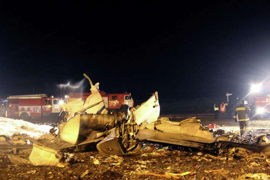 In this photo provided by Russian Emergency Situations Ministry, firefighters and rescuers work at the crash site of a Russian passenger airliner near Kazan, the capital of the Tatarstan republic, about 720 kilometers (450 miles) east of Moscow, on Sunday, Nov. 17, 2013. The Russian passenger airliner crashed Sunday night while trying to land at the airport in the city of Kazan, killing all 50 people onboard, officials said. The Boeing 737 belonging to Tatarstan Airlines crashed an hour after taking off from Moscow. There were no immediate indications of the cause. Photo: Uncredited, AP / THE ASSOCIATED PRESS2013