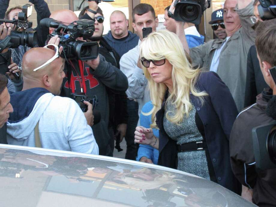 Dina Lohan leaves court in Hempstead, N.Y. in this Sept. 24, 2013 file photo after pleading not guilty to drunken driving charges. A judge on Thursday Nov. 21, 2013 referred Lindsay Lohan's mother to a community service program, saying volunteering could help her alleged drunken-driving case. Photo: Frank Eltman, AP / A2013