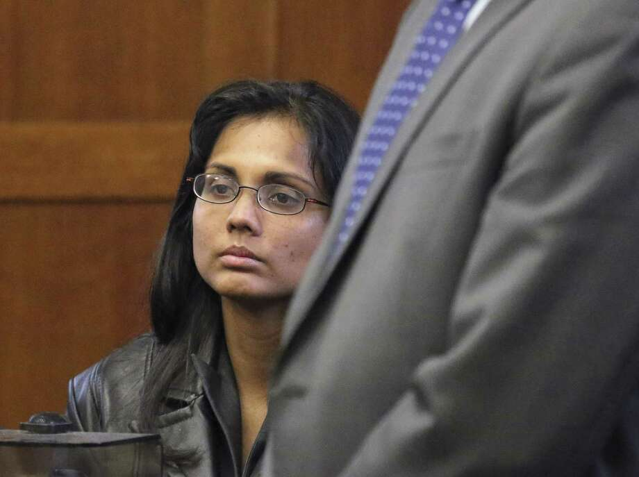 Former state chemist Annie Dookhan sits during a hearing Friday, Nov. 22, 2013, in Suffolk Superior Court in Boston, where she entered a guilty plea on charges of obstruction of justice, perjury and tampering with evidence. Dookhan, who admitted faking test results in criminal cases, was sentenced to three to five years in prison, followed by two years' probation. Photo: David L. Ryan, AP / The Boston Globe, Pool