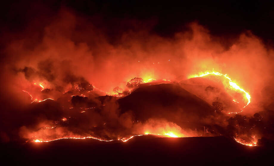 Fire rages along the steep slopes of the Geysers geothermal field, Friday morning, Nov. 22, 2013, east of Geyserville, Calif. Photo: Kent Porter, AP / The Press Democrat