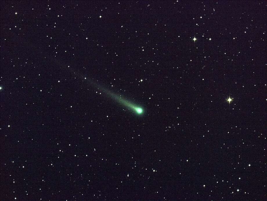 In this photo provided by NASA, Comet ISON shines in this five-minute exposure taken at NASA's Marshall Space Flight Center on Nov. 8 at 5:40 a.m. EST.  At the time of this picture, Comet ISON was 97 million miles from Earth, heading toward a close encounter with the sun on Nov. 28. Located in the constellation of Virgo, it is now visible in a good pair of binoculars. Photo: Aaron Kingery, AP / NASA