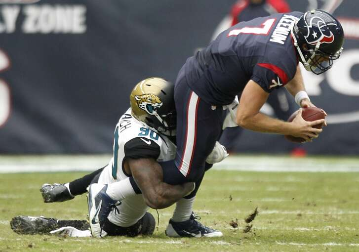 Texans quarterback Case Keenum gets sacked against the Jaguars.