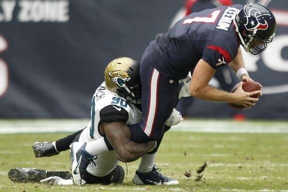 Texans quarterback Case Keenum gets sacked against the Jaguars.