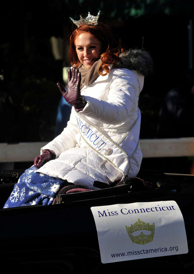 Miss Connecticut Kaitlyn Tarpey waves to the crowd gathered for the UBS Parade Spectacular in downtown Stamford, Conn., on Sunday, Nov. 24, 2013. Photo: Jason Rearick / Stamford Advocate