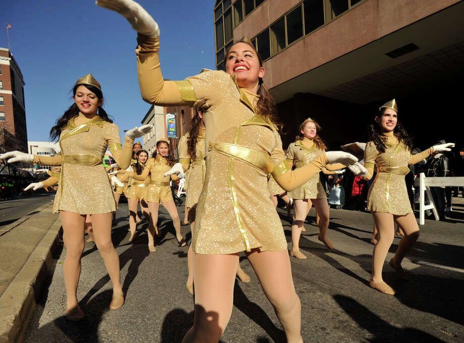Carly Schwartz, center, dances with the rest of the City Center Dance team during the UBS Parade Spectacular in downtown Stamford, Conn., on Sunday, Nov. 24, 2013. Photo: Jason Rearick / Stamford Advocate